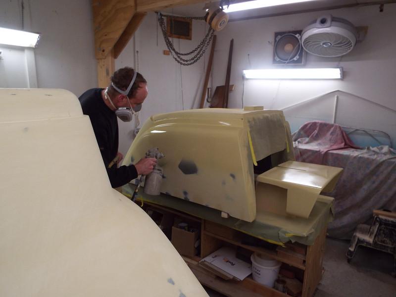 Applying the third coat of primer.