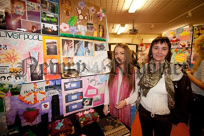 Hannah Stewart is pictured with her Art work at St mary's A-Level art exhibition. Also pictured is her mother Monica stewart. R1520010