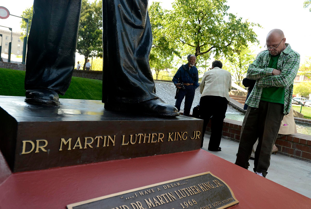 . Robert Earl Luckett, of San Bernardino, admires the newly restored Martin Luther King, Jr. statue in downtown San Bernardino April 12, 2013.  GABRIEL LUIS ACOSTA/STAFF PHOTOGRAPHER.