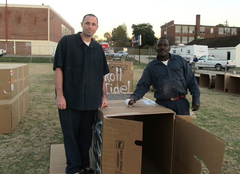 """2010 12/03  Community helpers bring in hundreds of big boxes for """"Homeless for the Night"""" fundraiser. kr"""