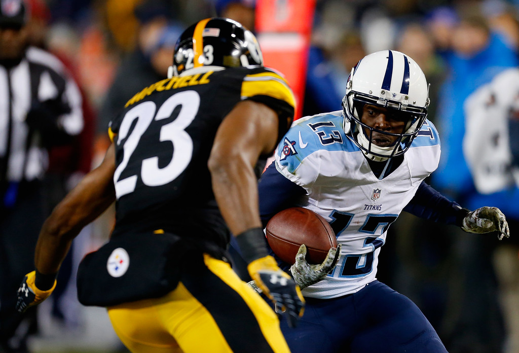 . NASHVILLE, TN - NOVEMBER 17:   Kendall Wright #13 of the Tennessee Titans carries the ball against  Mike Mitchell #23 of the Pittsburgh Steelers in the second quarter of the game at LP Field on November 17, 2014 in Nashville, Tennessee.  (Photo by Wesley Hitt/Getty Images)