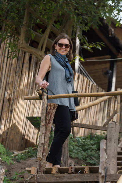 Portrait of happy woman standing on a staircase, Luang Prabang, Laos