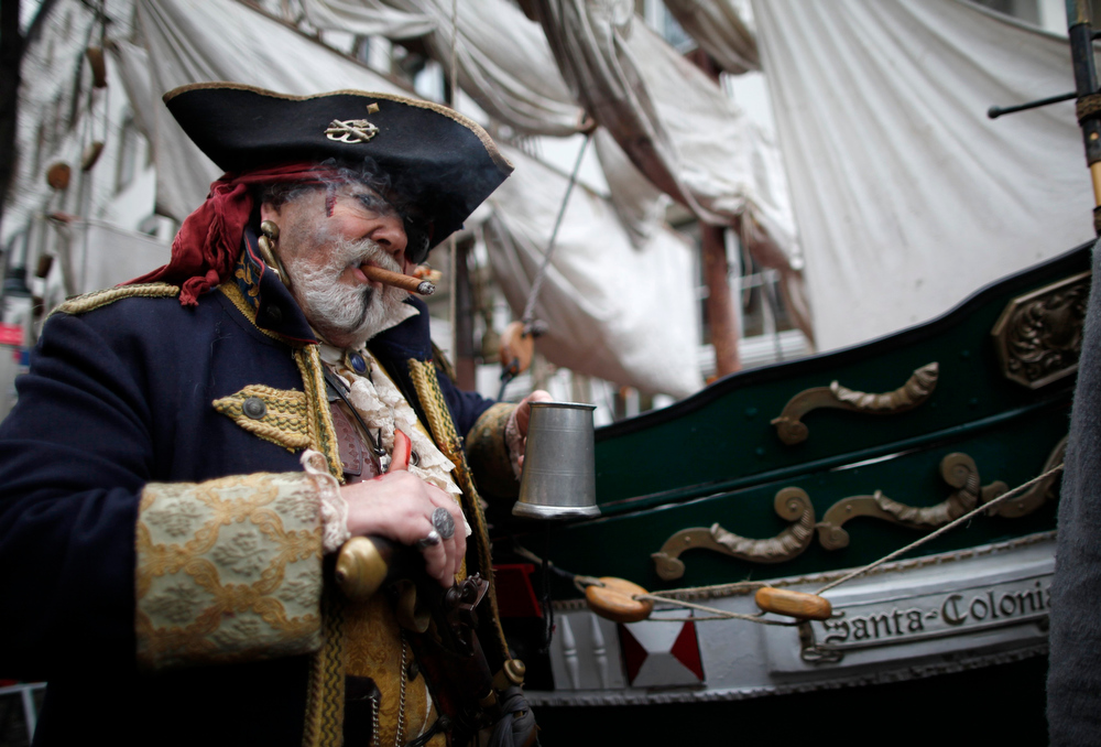 ". A man dressed as a pirate poses during ""Weiberfastnacht\"" (Women\'s Carnival) in Cologne February 7, 2013. Women\'s Carnival marks the start of a week of street festivals, the highlight of the event being \""Rosenmontag\"" (Rose Monday), the final day of the carnival where mass processions are held. REUTERS/Ina Fassbender"