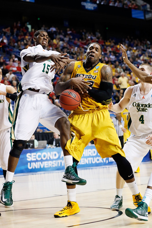 . LEXINGTON, KY - MARCH 21:  Alex Oriakhi #42 of the Missouri Tigers fights for the loose ball against Gerson Santo #15 of the Colorado State Rams during the second round of the 2013 NCAA Men\'s Basketball Tournament at the Rupp Arena on March 21, 2013 in Lexington, Kentucky.  (Photo by Kevin C. Cox/Getty Images)