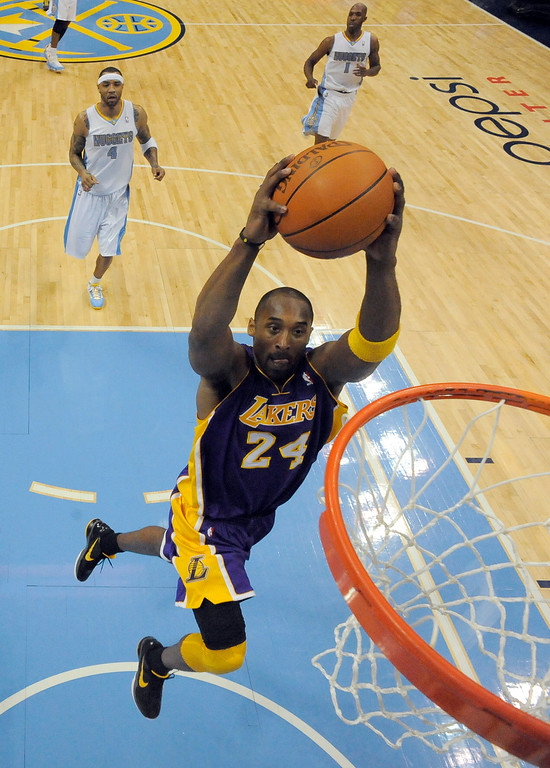 . Los Angeles Lakers shooting guard Kobe Bryant (24) gets an easy dunk in the fourth quarter against the Denver Nuggets January 21, 2011 at Pepsi Center.  John Leyba, The Denver Post