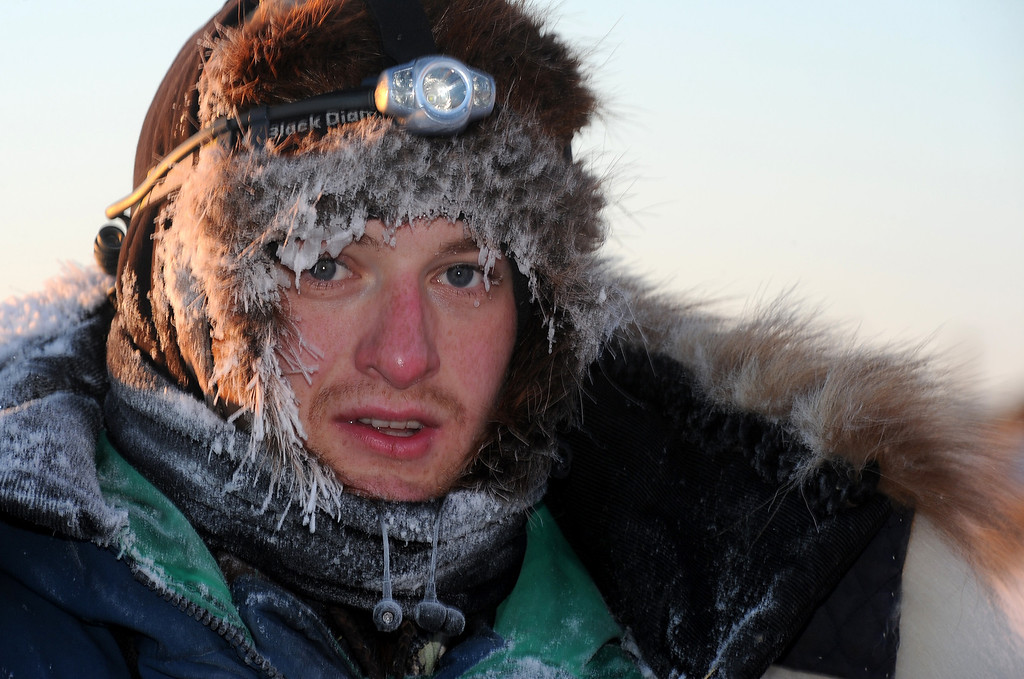 . Iditarod musher Wade Marrs, from Wasilla, AK, arrives at the Unalakleet checkpoint at sunrise during the 2014 Iditarod Trail Sled Dog Race on Sunday, March 9, 2014. (AP Photo/The Anchorage Daily News, Bob Hallinen)