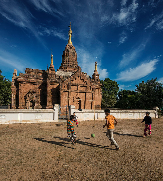 Kids playing football in front of a temple.  Bagan, Myanmar, 2017