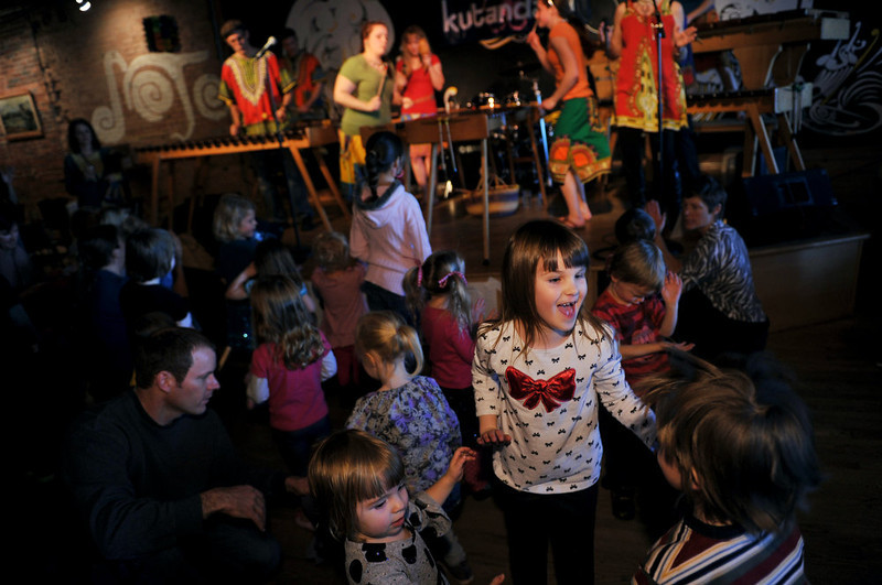 . ARVADA, CO - JANUARY 19: Izzy Sprenger, 6, of Arvada, front top, and children are dancing with African Music by Kutandara Marimba Ensemble at the D-Note in Olde Town Aravada. The Music Train Family Concert Series presents an established Colorado band, showcasing a different genre of music, every month from October through May. (Photo By Hyoung Chang / The Denver Post)