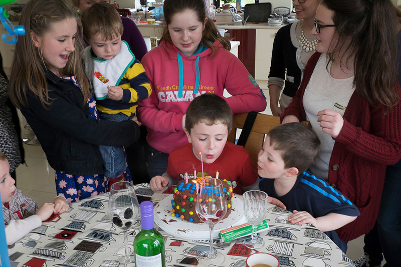 Oisín got help blowing out his candles.