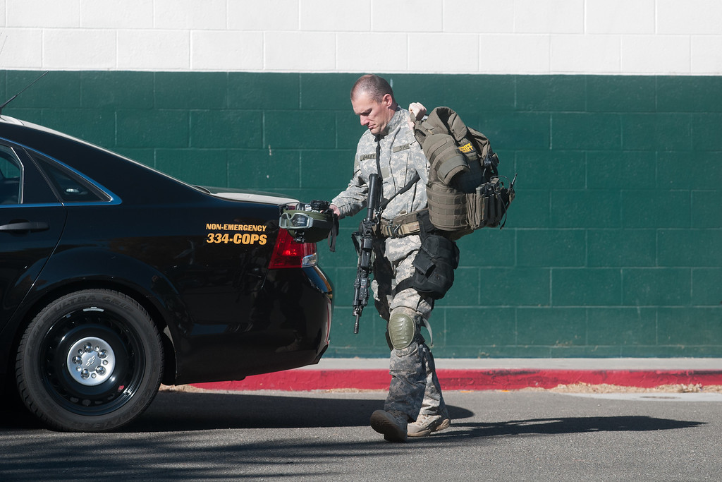 . A police officer walks to his vehicle after a shooting at Sparks Middle School October 21, 2013 in Sparks, Nevada.  (Photo by David Calvert/Getty Images)