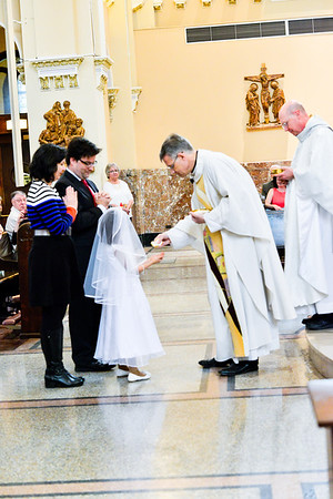 Receiving First Holy Communion  -  May 12, 2018