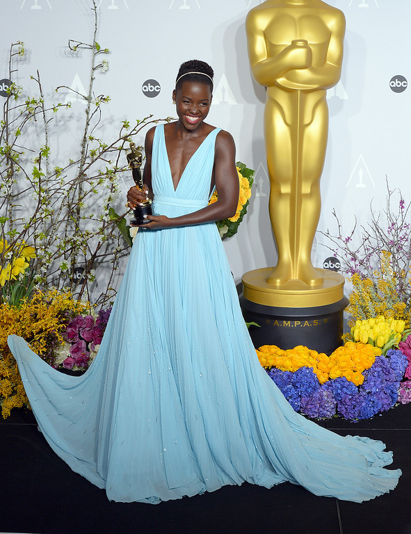 . Lupita Nyong\'o , who won the Oscar for Performance by an Actress in a Supporting Role, backstage at the 86th Academy Awards at the Dolby Theatre in Hollywood, California on Sunday March 2, 2014 (Photo by David Crane / Los Angeles Daily News)