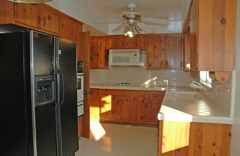 Large kitchen has plenty of storage.