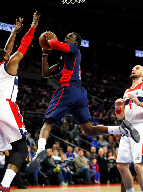 . Detroit Pistons\' Reggie Jackson drives against the Washington Wizards in the first half of an NBA basketball game in Auburn Hills, Mich., Sunday, Feb. 22, 2015. (AP Photo/Paul Sancya)