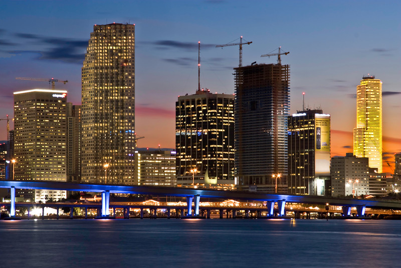 Skyline of downtown Miami at sunset. The building on then far right changes color at different times. This day it was yellow . In another photo in this gallery it is red.