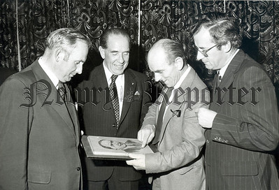 Mr. G. Haugh,, Omeath describing a detail in a wood carved portrait of Mr. Tully which Mr. T. Elmore Chairman of Omeath Development Association (left) presented to Minister for Local Government Mr. Tully (Centre). On right is Mr. M. Burke Officer Regional Marketing.