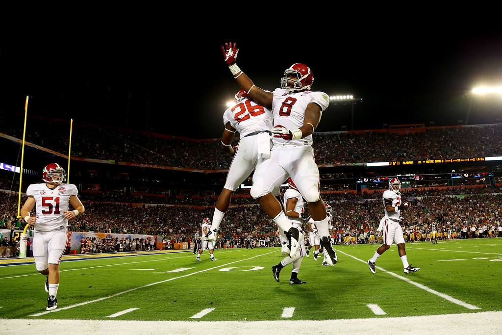 . MIAMI GARDENS, FL - JANUARY 07:  Landon Collins #26 of the Alabama Crimson Tide and Jeoffrey Pagan #8 celebrate after pinning the Notre Dame Fighting Irish deep in their own territory during the 2013 Discover BCS National Championship game at Sun Life Stadium on January 7, 2013 in Miami Gardens, Florida.  (Photo by Mike Ehrmann/Getty Images)