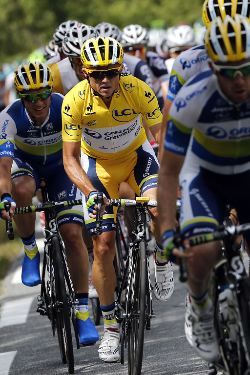 . Overall leader\'s yellow jersey Australia\'s Simon Gerrans (C) rides with his teammates during the 228.5 km fifth stage of the 100th edition of the Tour de France cycling race on July 3, 2013 between Cagnes-sur-Mer and Marseille, southern France.  AFP PHOTO / JEFF  PACHOUD/AFP/Getty Images