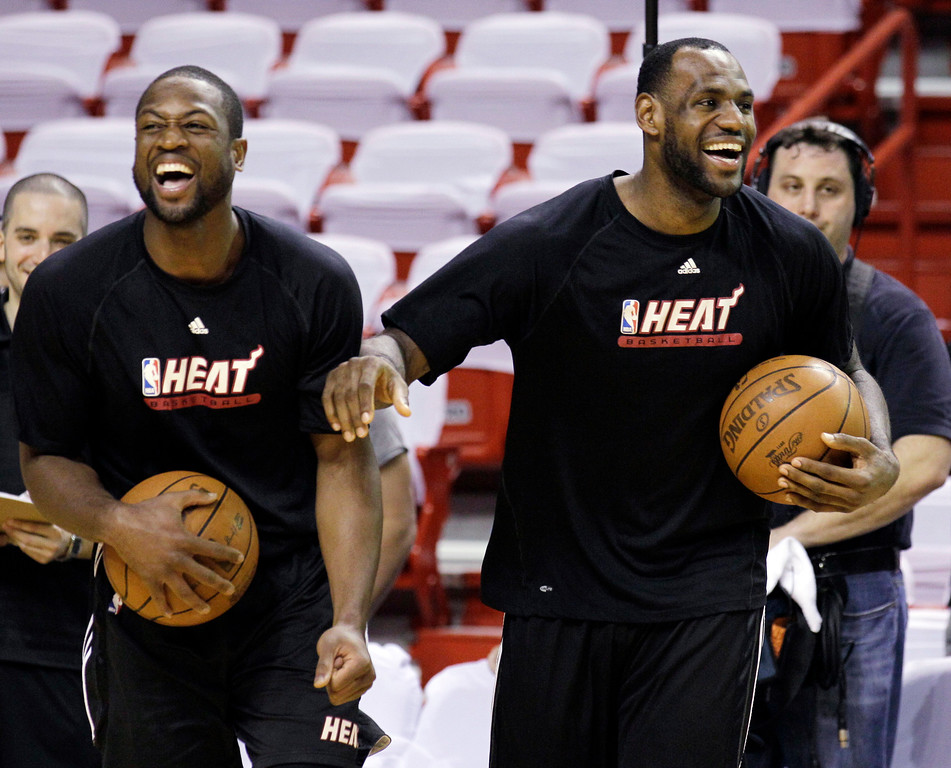 . Miami Heat\'s Dwyane Wade, left, and LeBron James laugh during a practice session for Game 6 of the NBA Finals against the Dallas Mavericks, Saturday, June 11, 2011, in Miami. The Mavericks lead the series 3-2. (AP Photo/Mark Humphrey)
