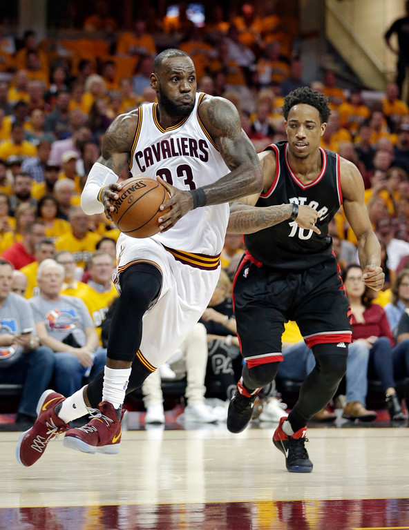 . Cleveland Cavaliers\' LeBron James (23) drives past Toronto Raptors\' DeMar DeRozan (10) in the second half in Game 1 of a second-round NBA basketball playoff series, Monday, May 1, 2017, in Cleveland. The Cavaliers won 116-105. (AP Photo/Tony Dejak)