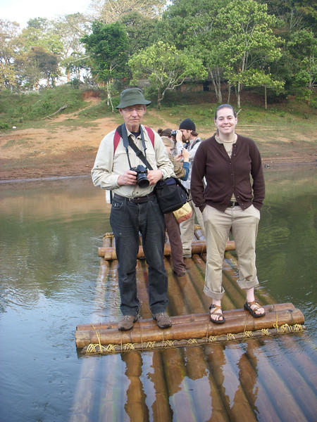 Cheryl riding a hand-powered bamboo ferry in the Periyar Wildlife Preserve