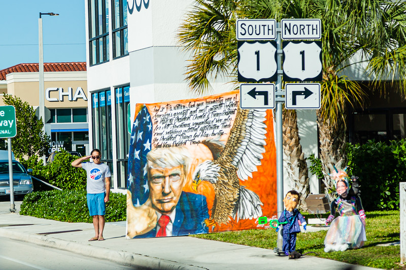 A supporter of President Donald J. Trump salutes as the Presidential motorcade passes by on Southern Blvd., on Sunday, January 05, 2020. [JOSEPH FORZANO/palmbeachpost.com]