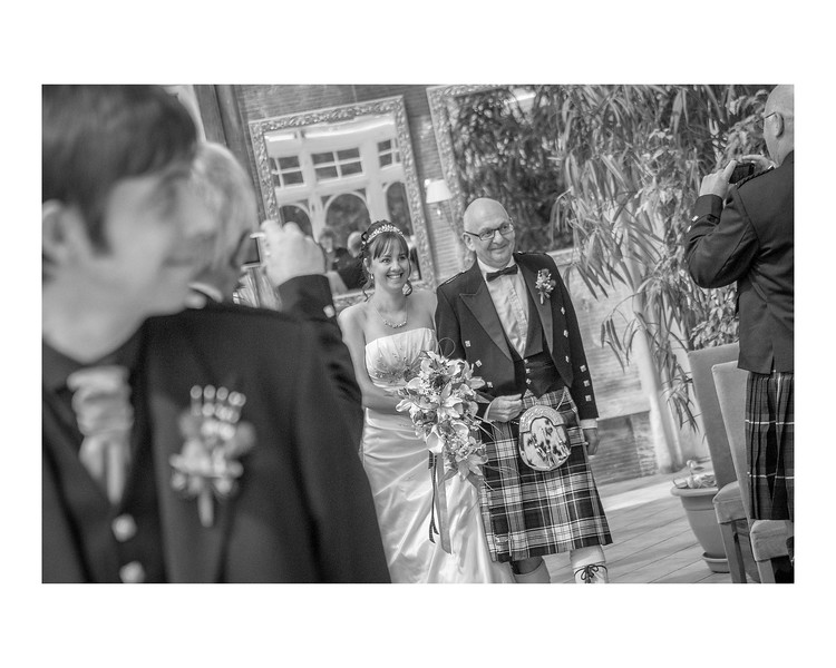 Wedding Photography of Jaqueline & Ryan, Kincaid House, Scotland, Photograph is of the Bride being walked down the aisle by her Dad