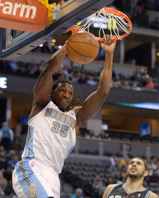 . DENVER, CO - OCTOBER 14: Denver Nuggets small forward Kenneth Faried (35) goes up for a big dunk against the San Antonio Spurs October 14, 2013 at Pepsi Center. (Photo By John Leyba/The Denver Post)