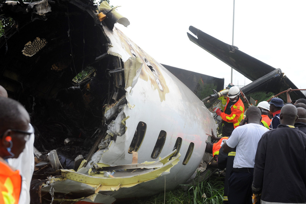 . Nigerian rescue workers gather around the wreckage of an Associated Airlines plane that crash-landed at Sahara Airport shortly after takeoff in Lagos on October 3, 2013.  AFP PHOTO/ PIUS UTOMI EKPEI /AFP/Getty Images