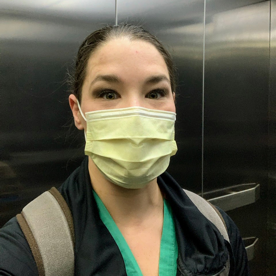Sara in a mask in the hospital elevator, April 7, 2020