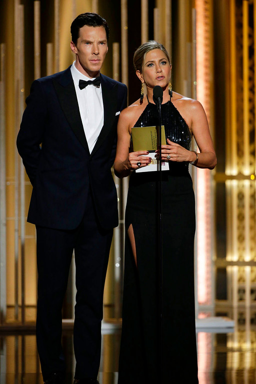 . In this image released by NBC, Benedict Cumberbatch,  left, and Jennifer Aniston present an award at the 72nd Annual Golden Globe Awards on Sunday, Jan. 11, 2015, at the Beverly Hilton Hotel in Beverly Hills, Calif. (AP Photo/NBC, Paul Drinkwater)