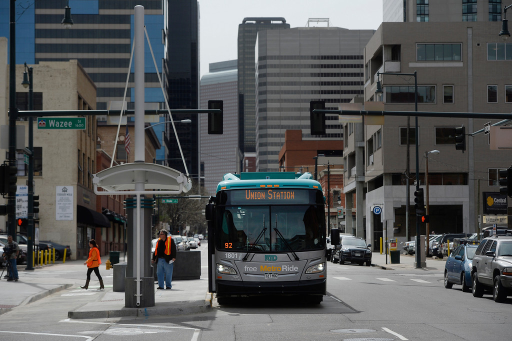 . DENVER, CO. - APRIL 25: The new RTD Free MetroRide. parked at 18th and Wazee for a media tour, Friday morning, April 25, 2014. This free bus service, which begins May 12, 2014, originates from Union Station, heads east up 19th Ave to Broadway, turns at 16th to Lincoln and then heads back to the station with various stops throughout before making it\'s way back to the Union State Transit Center. (Photo By Andy Cross / The Denver Post)