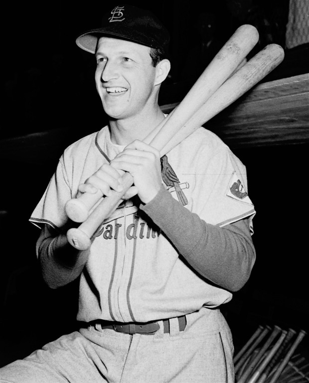 . FILE - In this Feb. 25, 1952, file photo, St. Loius Cardinals; Stan Musial poses with his bats on his shoulder as he put on his St. Louis Cardinal uniform for the first time this season at spring training baseball in St. Petersburg, Fla. Musial, one of baseball\'s greatest hitters and a Hall of Famer with the St. Louis Cardinals for more than two decades, died Saturday, Jan 19, 2013, the Cardinals announced. He was 92. (AP Photo/Stroup, File)