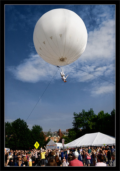 Heliosphere in the Clouds  The crowd watches arial acrobatics performed from a giant helium ballon (Heliosphere)  The Dream Engine Heliosphere  Ann Arbor Summer Festival: Top of the Park University of Michigan, Ann Arbor  27-JUN-2008
