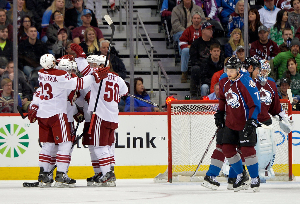 . Colorado Avalanche center John Mitchell (7) reacts as Phoenix Coyotes defenseman Oliver Ekman-Larsson (23), Keith Yandle (3), Shane Doan (19) and Antoine Vermette (50) celebrate a Doan goal against Avalanche goalie Semyon Varlamov, right, during the first period of an NHL hockey game on Friday, Feb. 28, 2014, in Denver. (AP Photo/Jack Dempsey)