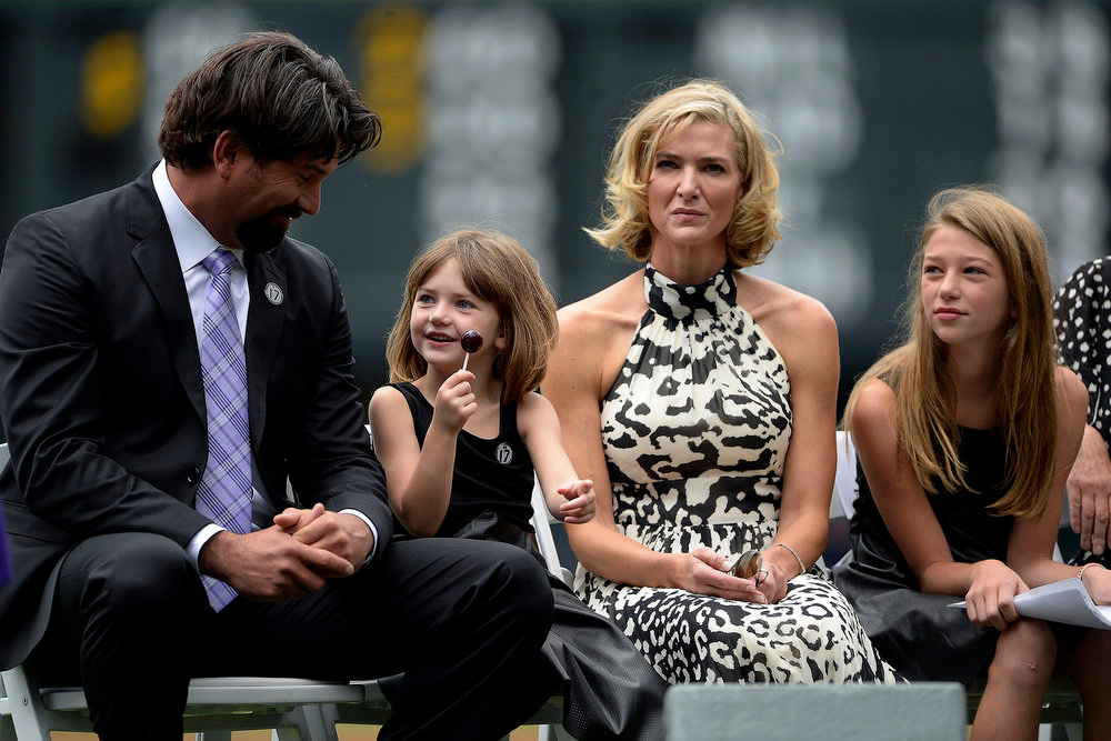. Colorado Rockies great Todd Helton sits with his wife and two daughters from left to right, Gentry Grace, Christy and Tierney Faith during a retirement ceremony for his number 17. Helton, who played 17 season with the Rockies and holds records for many of the organizations career statistics, was honored on Sunday, August 17, 2014. (Photo by AAron Ontiveroz/The Denver Post)