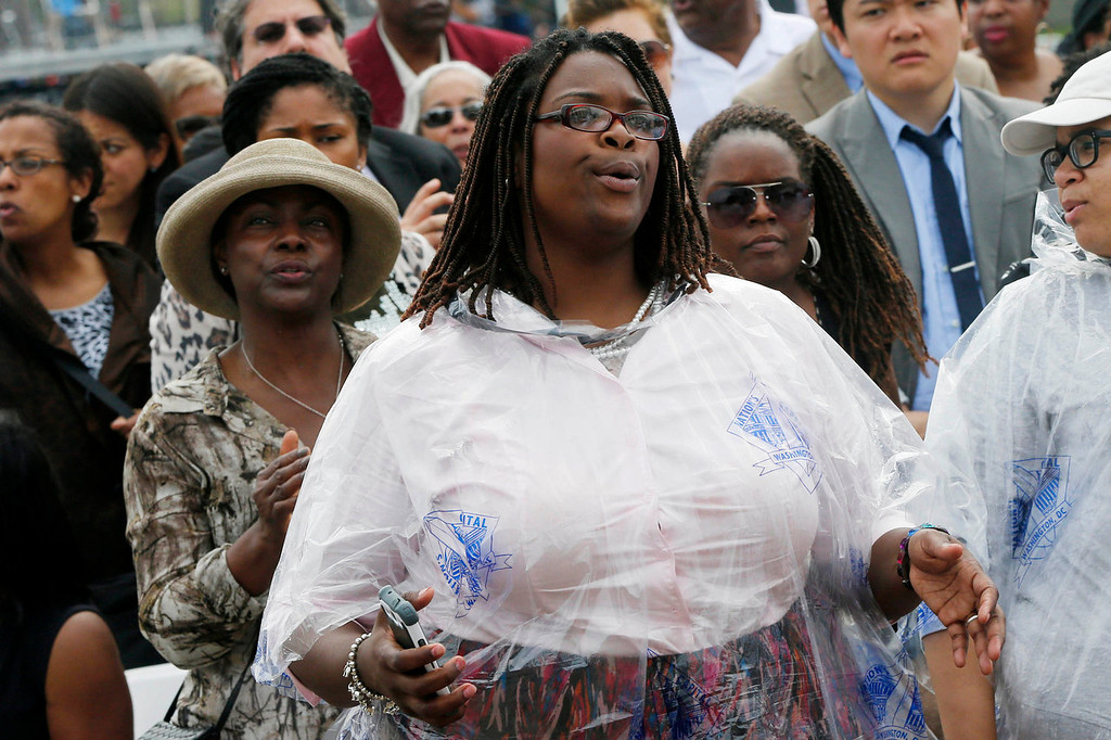 . Audience members sing during the benediction for the 50th Anniversary of the March on Washington where Martin Luther King, Jr., spoke, Wednesday, Aug. 28, 2013, in front of the Lincoln Memorial in Washington. (AP Photo/Charles Dharapak)
