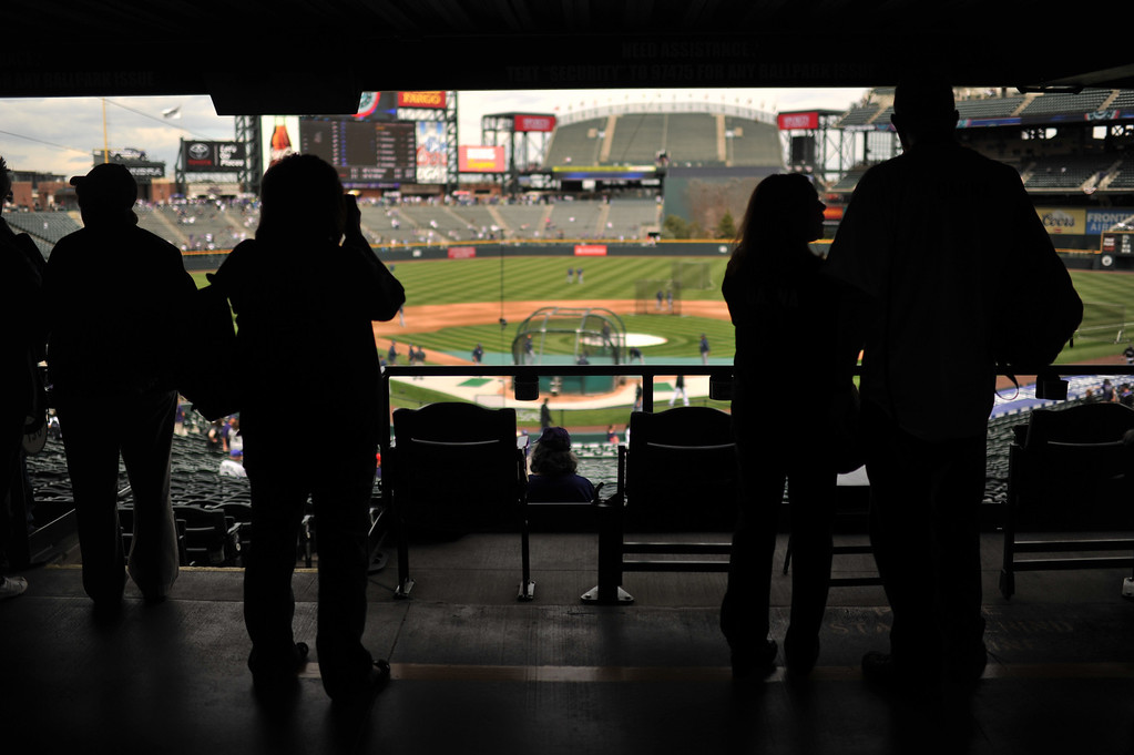 . Fans check out the field for the first time this season. The Colorado Rockies took on the San Diego Padres on Opening Day at Coors Field in Denver, Colorado. (Photo by Hyoung Chang/The Denver Post)