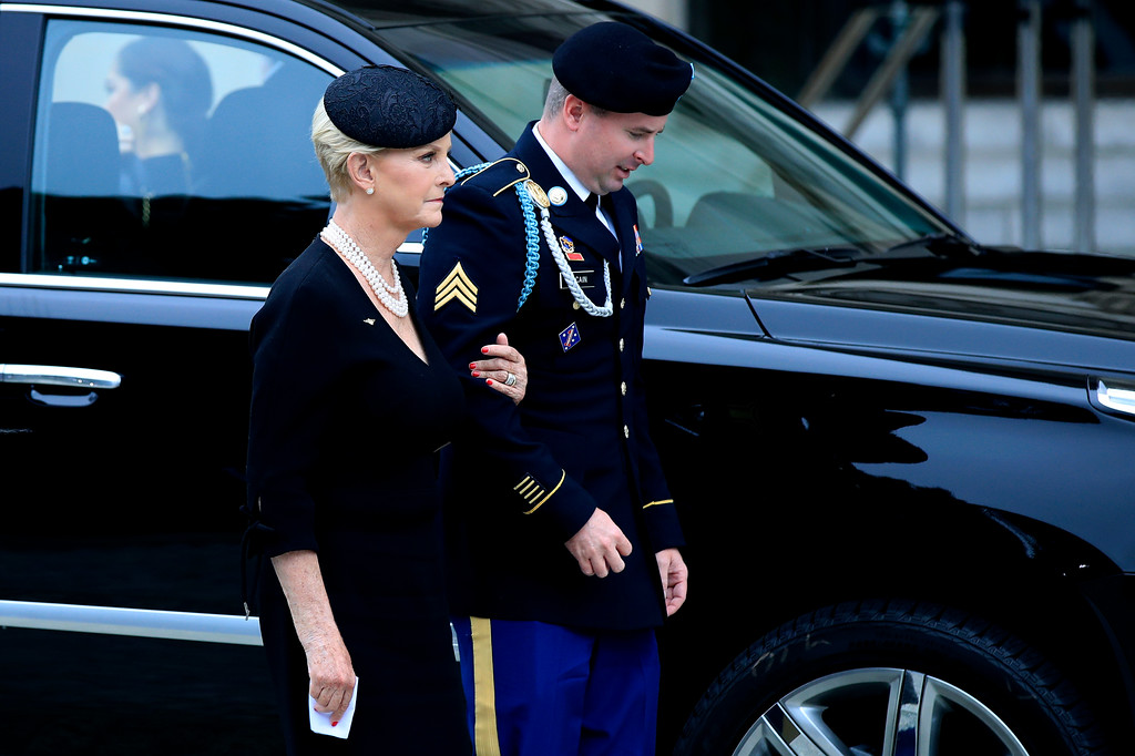 . Cindy McCain, left, and her son Jimmy McCain, right, follow the casket of Sen. John McCain, R-Ariz., as it arrives at the Washington National Cathedral in Washington, Saturday, Sept. 1, 2018, for a memorial service. McCain died Aug. 25 from brain cancer at age 81. (AP Photo/Manuel Balce Ceneta)