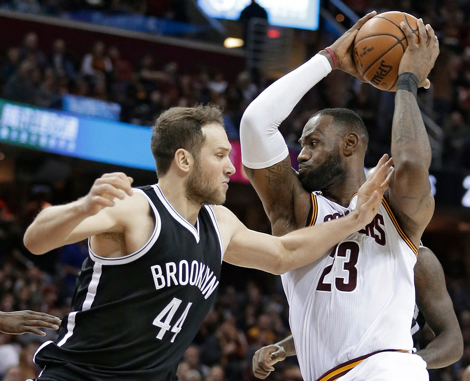 . Cleveland Cavaliers\' LeBron James (23) drives past Brooklyn Nets\' Bojan Bogdanovic (44) during pthe second half of an NBA basketball game, Friday, Jan. 27, 2017, in Cleveland. The Cavaliers won 124-116. (AP Photo/Tony Dejak)