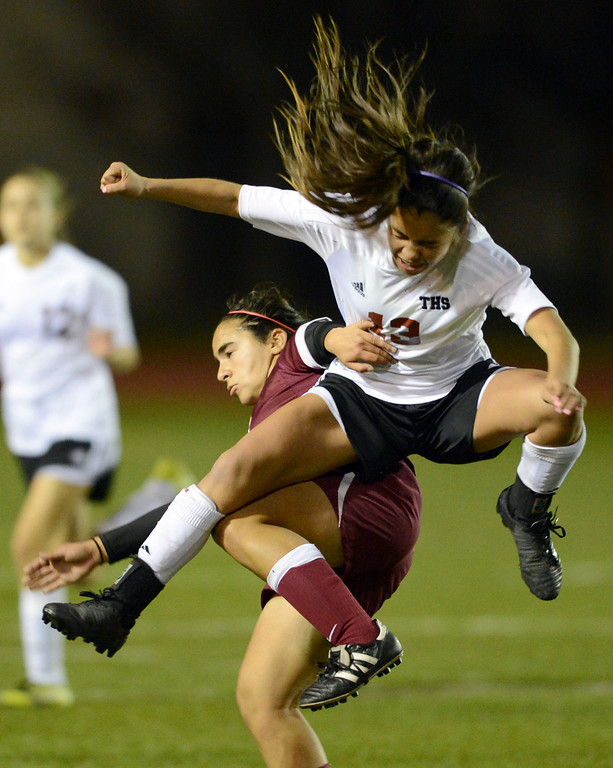 . Torrance\'s Kealani Tiratira (13) crashes down on Downey\'s Tara Kazimi (22) in a CIF SS Division IV quarterfinal game Thursday at Zamperini Field. Downey won the game 3-1. 20130221 Photo by Steve McCrank / Staff Photographer