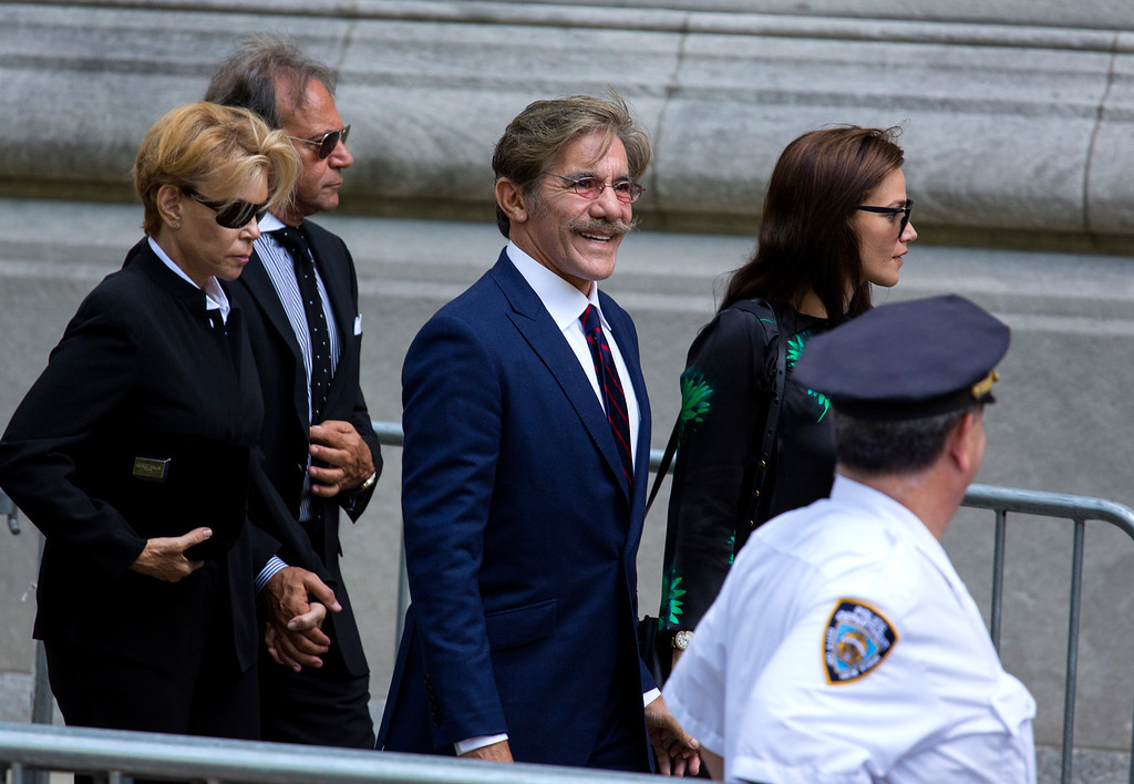 . Geraldo Rivera, center, arrives at a funeral service for comedian Joan Rivers at Temple Emanu-El in New York Sunday, Sept. 7, 2014. Rivers died Thursday, Sept. 4, 2014. She was 81. (AP Photo/Craig Ruttle)