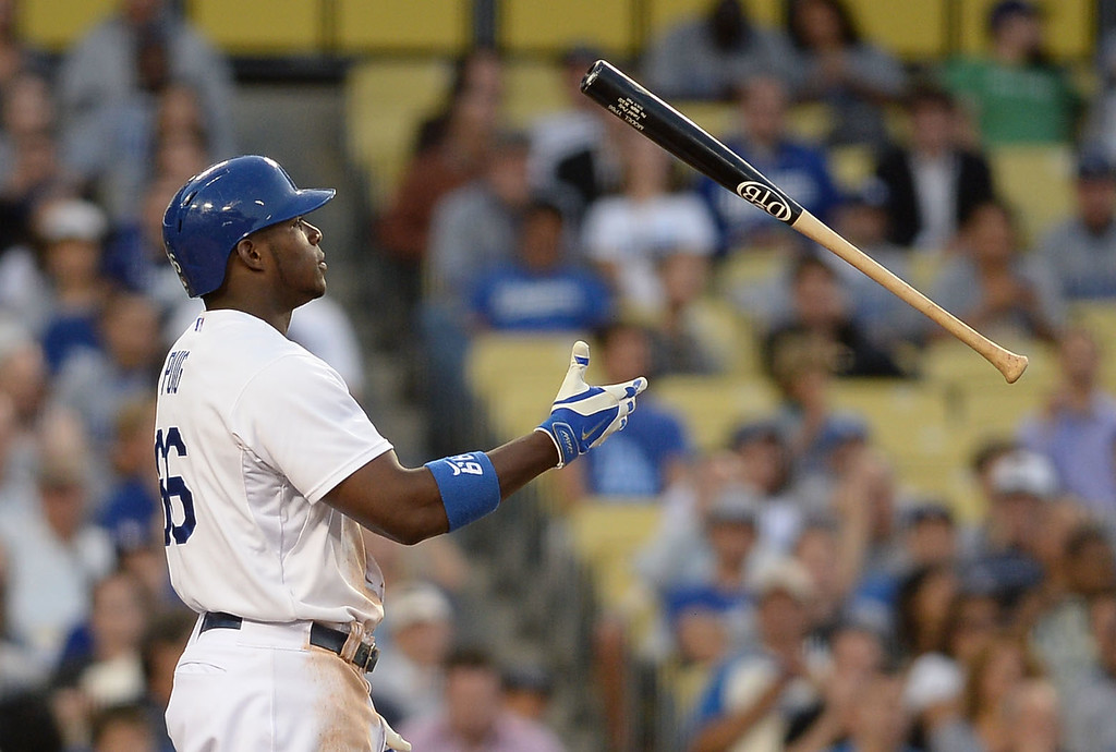 . Los Angeles Dodgers Yasiel Puig flips his bat after striking out in the 2nd inning against the Cleveland Indians July 1, 2014 in Los Angeles.(Andy Holzman/Los Angeles Daily News)