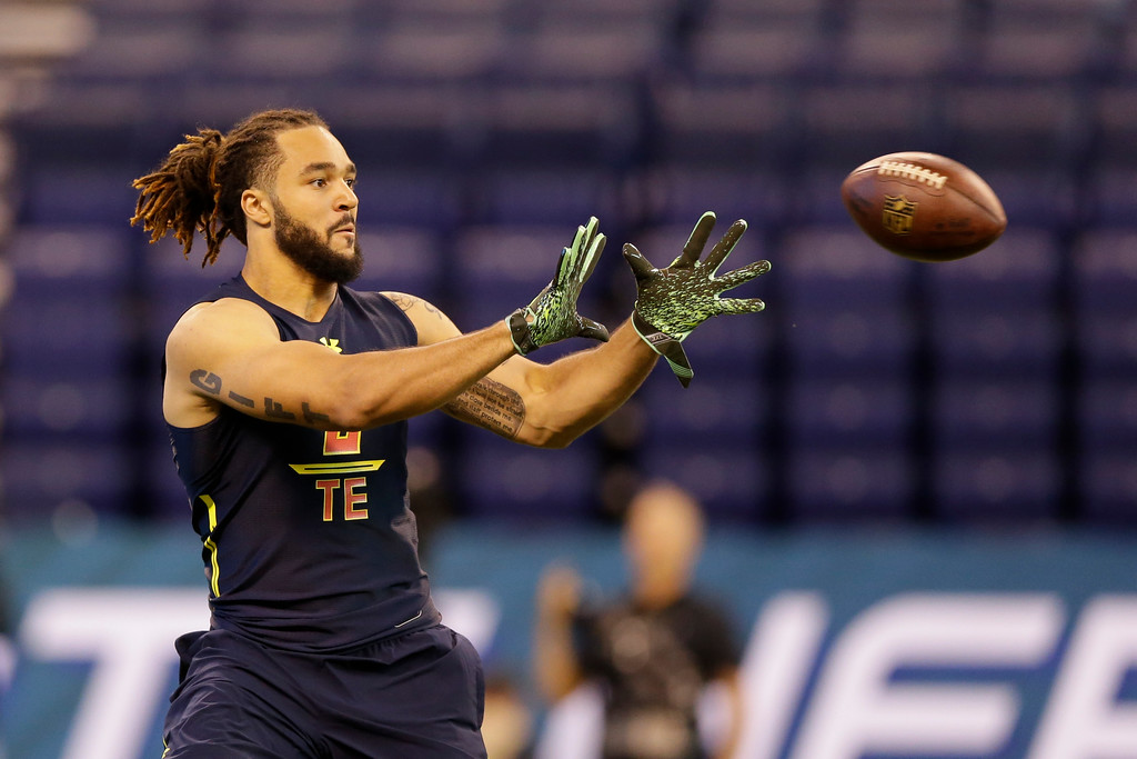 . Virginia Tech tight end Bucky Hodges runs a drill at the NFL football scouting combine in Indianapolis, Saturday, March 4, 2017. (AP Photo/Michael Conroy)