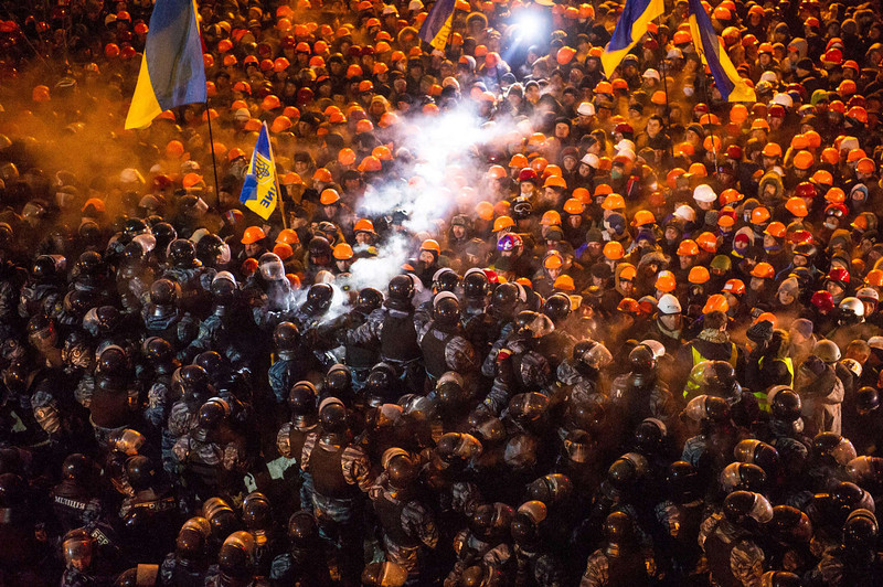 ". Riot police clash with pro-EU protesors on Independence Square in Kiev early on December 11,2013. Ukrainian security forces  stormed Kiev\'s Independence Square which protesters have occupied for over a week but the demonstrators defiantly refused to leave and resisted the police in a tense standoff. Eite Berkut anti-riot police and interior ministry special forces moved against the protestors at around 2:00 am (midnight GMT) in a move that prompted US Secretary of State John Kerry to express ""disgust\"" over the crackdown. VOLODYMYR SHUVAYEV/AFP/Getty Images"