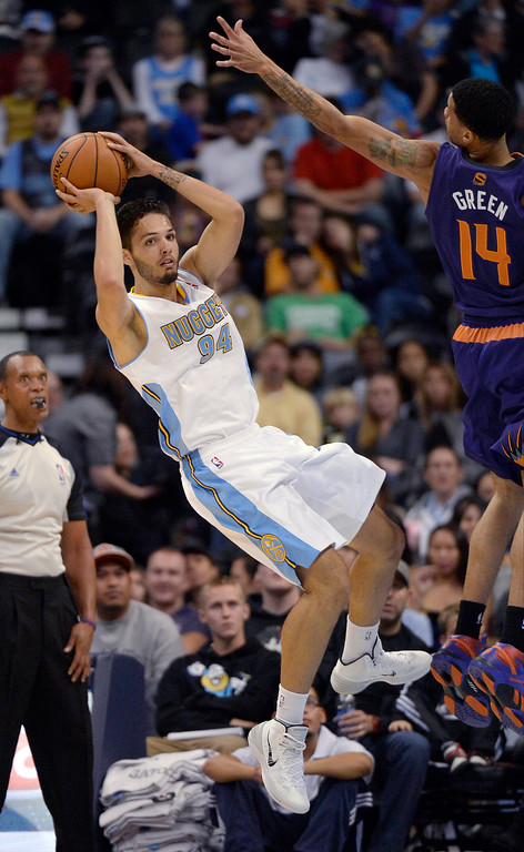 . Phoenix Suns shooting guard Gerald Green (14) forces Denver Nuggets shooting guard Evan Fournier (94) to make an off balance pass during the fourth quarter October 23, 2013 at Pepsi Center. (Photo By John Leyba/The Denver Post)
