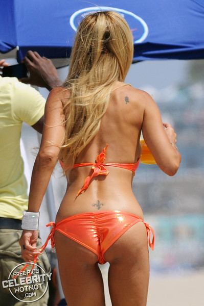 Shauna Sand Struggles To Walks On The Beach In Revealing Orange Bikini & Shows Off Her Huge Lips!