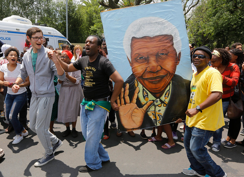 . Mourners sing songs outside the house of the late South African president Nelson Mandela in Johannesburg, South Africa, 06 December 2013. Nobel Peace Prize winner Nelson Mandela died at age 95, in Johannesburg, South Africa, on 05 December 2013. A former lawyer, Mandela was the first black President of South Africa voted into power after the countries first free and fair democratic elections that witnessed the end of the Apartheid system in 1994. Mandela was founding member of the ANC (African National Congress) and anti-apartheid activist who served 27 years in prison, spending many of these years on Robben Island. In South Africa, Mandela is often known as Tata Madiba, an honorary title adopted by elders of Mandela\'s clan. Mandela won the Nobel Peace Prize in 1993.  EPA/KIM LUDBROOK