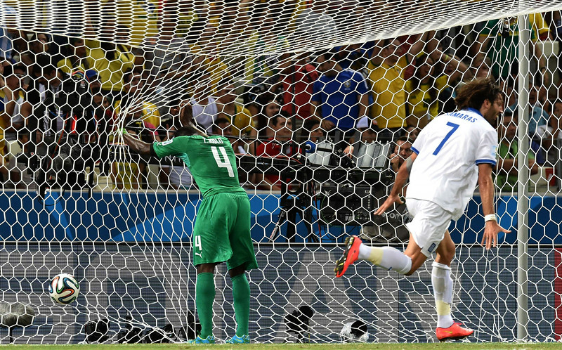 . Ivory Coast\'s defender Kolo Toure (L) reacts as Greece\'s forward Georgios Samaras celebrates after his team scored during a Group C football match between Greece and Ivory Coast at the Castelao Stadium in Fortaleza during the 2014 FIFA World Cup on June 24, 2014. (ISSOUF SANOGO/AFP/Getty Images)