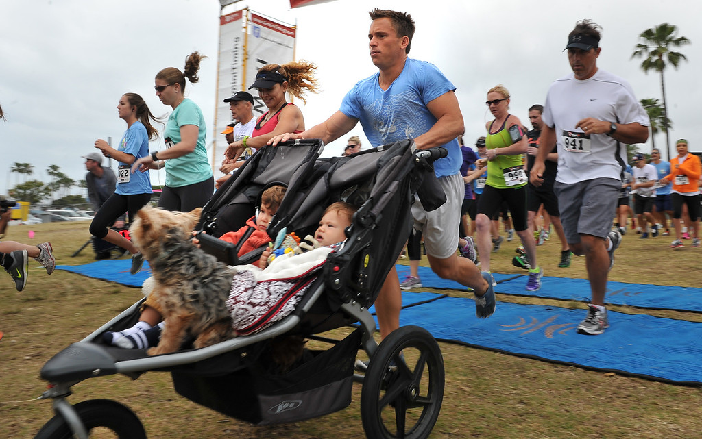 . 5/25/13 - The Guesno family along with other runners leave the starting line for the 10K at the Children Today\'s 5th Annual run/walk at Marina Green Park. The local non-profit, Children Today, is an organization that provides for families and children experiencing homelessness in Long Beach. They\'ve raised $33,184 and their final goal is $50,000. Photo by Brittany Murray / Staff Photographer